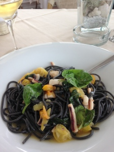 Squid ink spaghetti w/ calamari and yellow tomatoes (and loads of basil and oil and butter...).